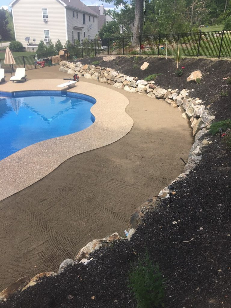 Wide view for loam, rock wall, pool